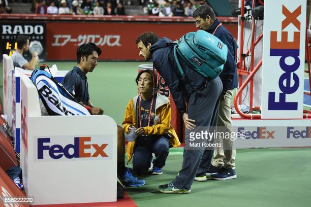 Yuichi Sugita of Japan reaceives attention during his quarterfinal match against Adrian Mannarino of France on day five of the Rakuten Open at Ariake...