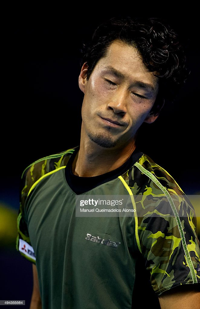 <a gi-track='captionPersonalityLinkClicked' href=/galleries/search?phrase=Yuichi+Sugita&family=editorial&specificpeople=2081175 ng-click='$event.stopPropagation()'>Yuichi Sugita</a> of Japan reacts against Mischa Zverev of Germany during day one of the ATP World Tour Valencia Open tennis tournament at the Ciudad de las Artes y las Ciencias on October 26, 2015 in Valencia, Spain.