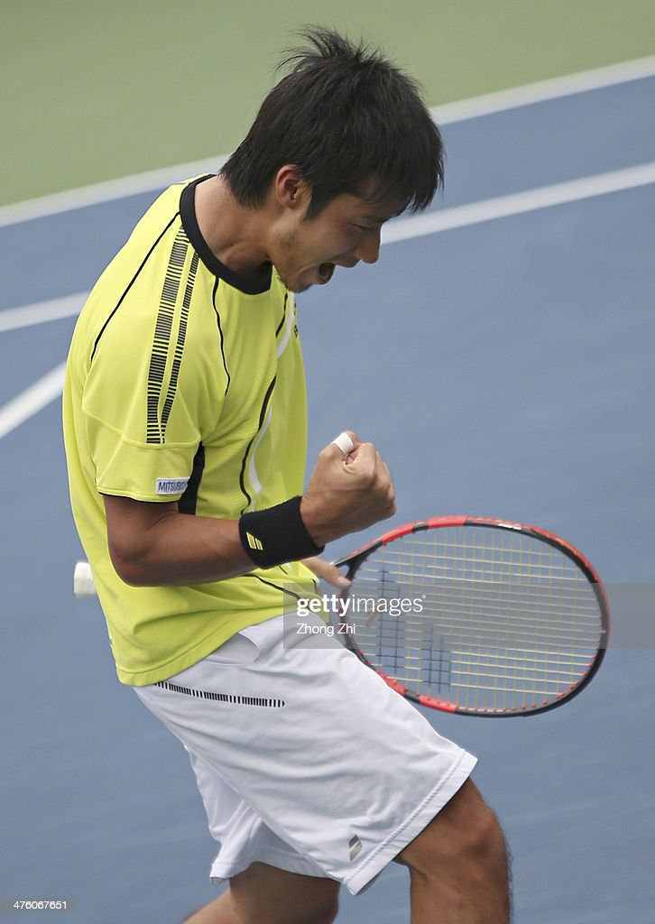 <a gi-track='captionPersonalityLinkClicked' href=/galleries/search?phrase=Yuichi+Sugita&family=editorial&specificpeople=2081175 ng-click='$event.stopPropagation()'>Yuichi Sugita</a> of Japan reacts during his final match against Blaz Rola of Slovenija on the ATP Challenger Guangzhou Tour at Guangzhou Development District International Tennis School on March 2, 2014 in Guangzhou, China.