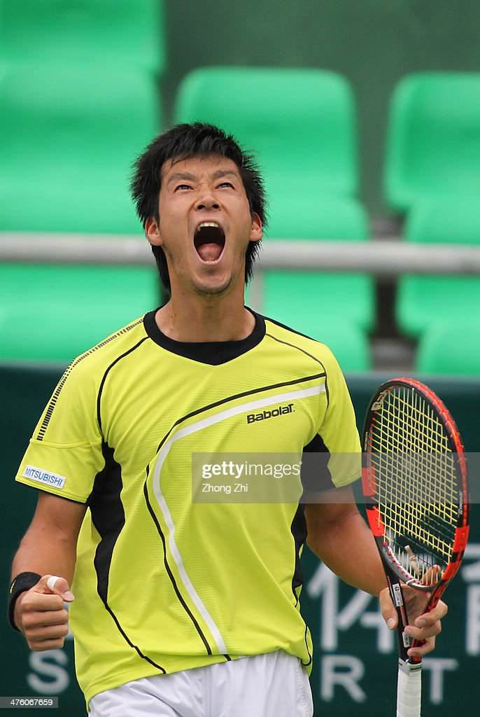 Yuichi Sugita of Japan reacts during his final match against Blaz Rola of Slovenija on the ATP Challenger Guangzhou Tour at Guangzhou Development District International Tennis School on March 2, 2014 in Guangzhou, China.