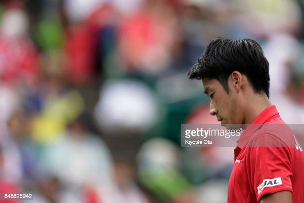 Yuichi Sugita of Japan reacts in his singles match against Thiago Monteiro of Brazil during day four of the Davis Cup World Group Playoff between...