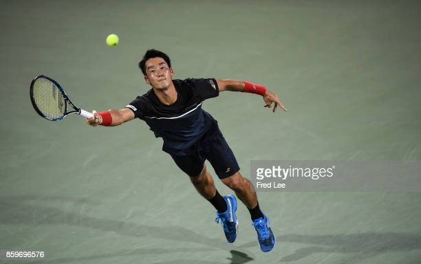 Yuichi Sugita of Japan returns a shot against during the Men's singles mach against Sam Querrey of United States on day 3 of Shanghai Rolex Masters...