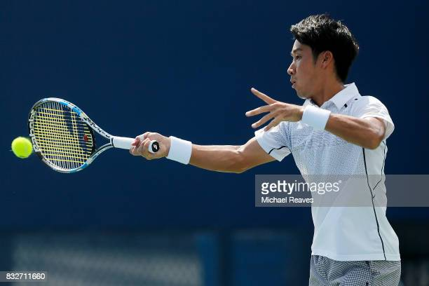 Yuichi Sugita of Japan returns a shot against Joao Sousa of Portugal during Day 5 of the Western and Southern Open at the Lindner Family Tennis...