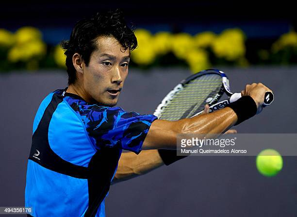 Yuichi Sugita of Japan returns a shot against Mischa Zverev of Germany during day one of the ATP World Tour Valencia Open tennis tournament at the...
