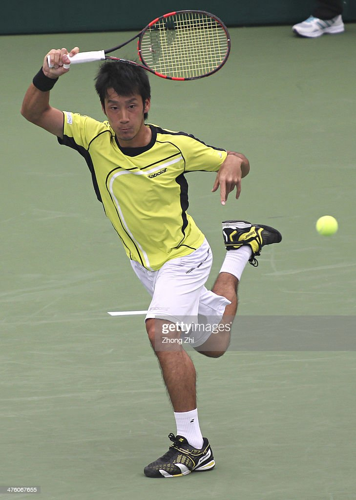 Yuichi Sugita of Japan returns a shot during his final match against Blaz Rola of Slovenija on the ATP Challenger Guangzhou Tour at Guangzhou...