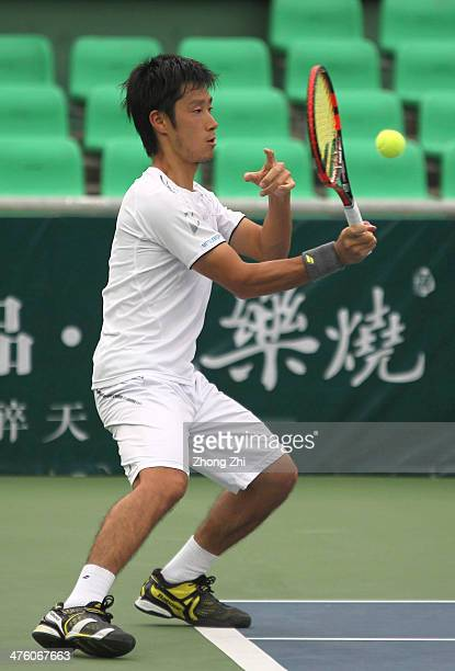 Yuichi Sugita of Japan returns a shot during his final match against Blaz Rola of Slovenija on the ATP Challenger Guangzhou Tour at Guangzhou...