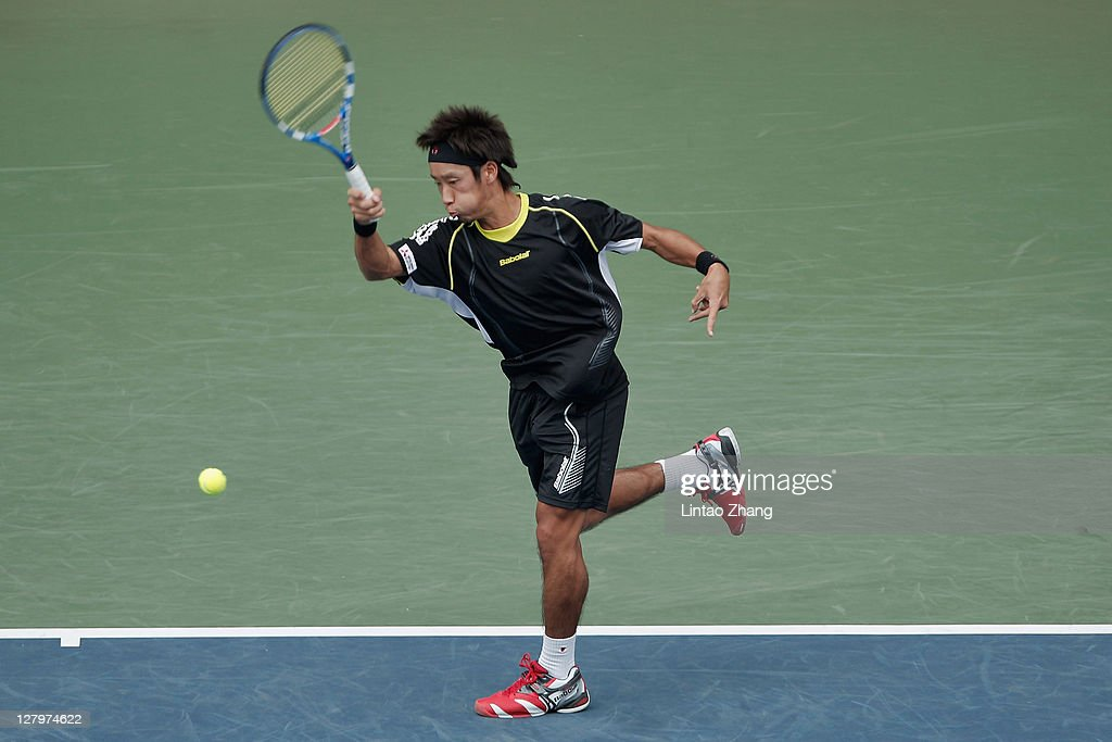 Yuichi Sugita of Japan returns a shot during his first round match against Milos Raonic of Canada during day two of the Rakuten Open at Ariake...