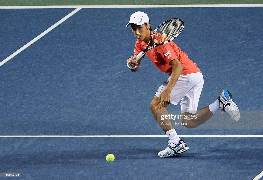 Yuichi Sugita of Japan returns a shot in the doubles game against Alejandro Falla and Juan-Sebastian Cabal of Colombia during day two of the Davis Cup World Group Play-Off at Ariake Colosseum on September 14, 2013 in Tokyo, Japan.