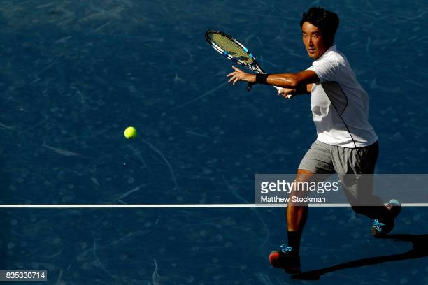 Yuichi Sugita of Japan returns a shot to Grigor Dimitrov of Bulgaria during day 7 of the Western Southern Open at the Lindner Family Tennis Center on...