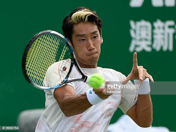 Yuichi Sugita of Japan returns a shot to Marcel Granollers of Spain in a match during second round of ATP Shanghai Rolex Masters 2016 on Day 3 at Qi...