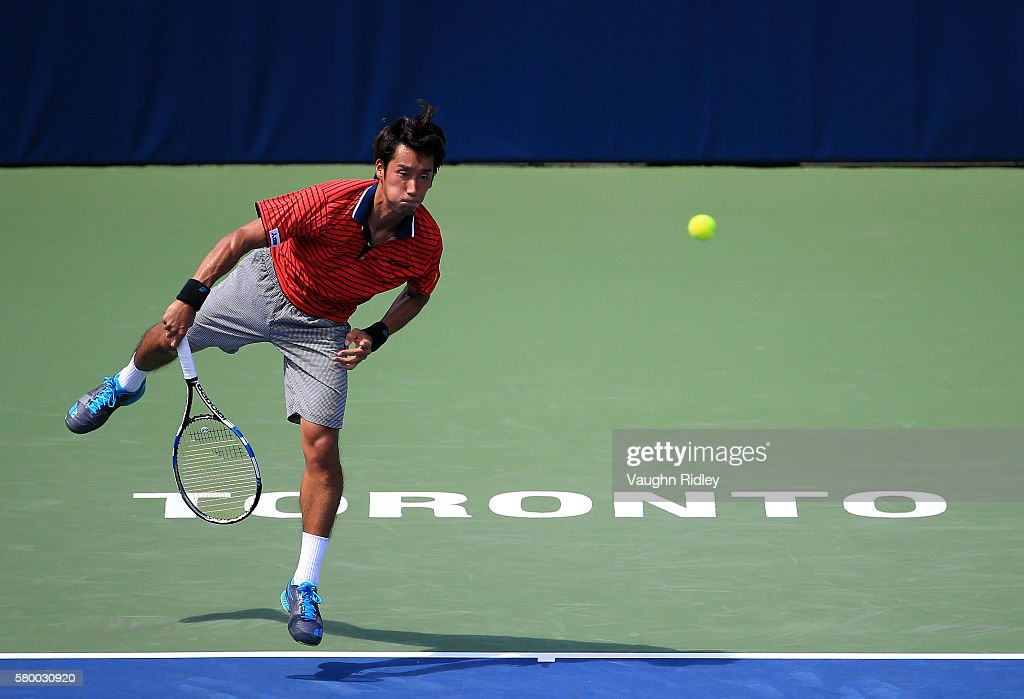 Yuichi Sugita of Japan serves against Grigor Dimitrov of Bulgaria during Day 1 of the Rogers Cup at the Aviva Centre on July 25 2016 in Toronto...