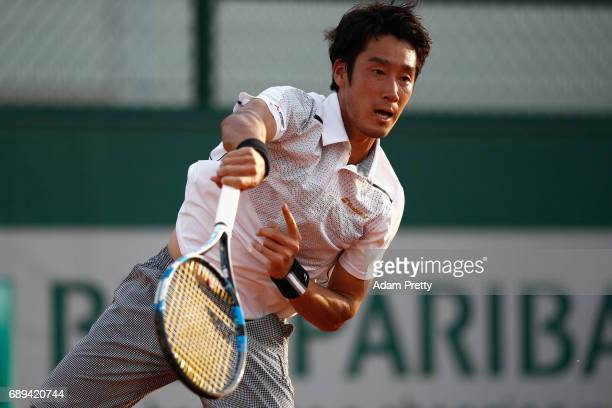 Yuichi Sugita of Japan serves during the mens singles first round match against Steve Johnson of The United States on day one of the 2017 French Open...