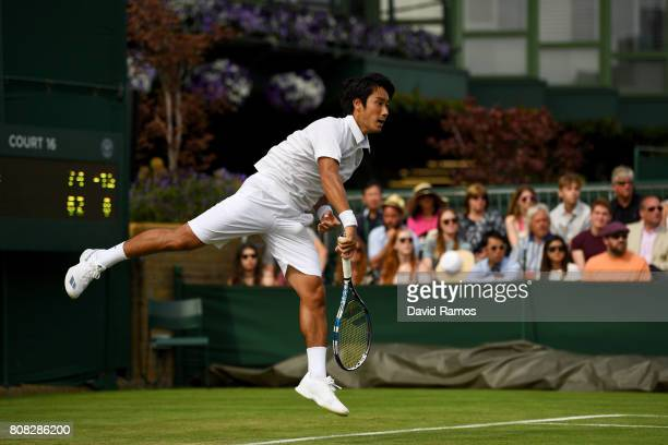 Yuichi Sugita of Japan serves first round match against Brydan Klein of Great Britian on day two of the Wimbledon Lawn Tennis Championships at the...