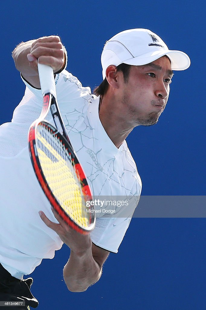 Yuichi Sugita of Japan serves in his match against Yasutaka Uchiyama of Japan during qualifying for the 2014 Australian Open at Melbourne Park on January 8, 2014 in Melbourne, Australia.