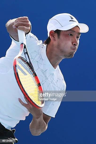 Yuichi Sugita of Japan serves in his match against Yasutaka Uchiyama of Japan during qualifying for the 2014 Australian Open at Melbourne Park on...