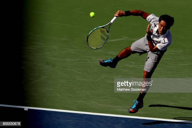 Yuichi Sugita of Japan serves to Grigor Dimitrov of Bulgaria during day 7 of the Western Southern Open at the Lindner Family Tennis Center on August...