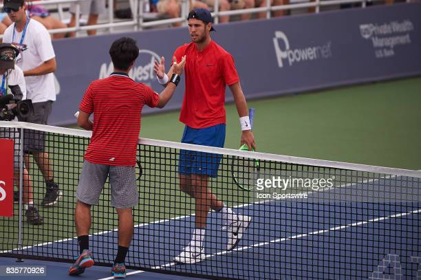 Yuichi Sugita of Japan shakes hands after winning his match against Karen Khachanov of Russia in the Western Southern Open at the Lindner Family...