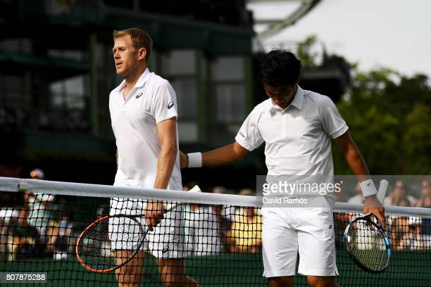 Yuichi Sugita of Japan shakes hands with Brydan Klein of Great Britain after their Gentlemen's Singles first round match against on day two of the...