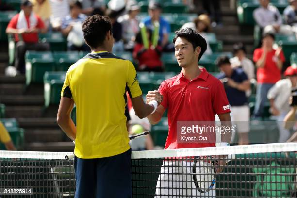 Yuichi Sugita of Japan shakes hands with Thiago Monteiro of Brazil after their singles match during day four of the Davis Cup World Group Playoff...
