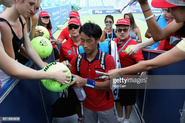 Yuichi Sugita of Japan signs autographs after defeating Jack Sock during the Western and Southern Open on August 15 2017 in Mason Ohio