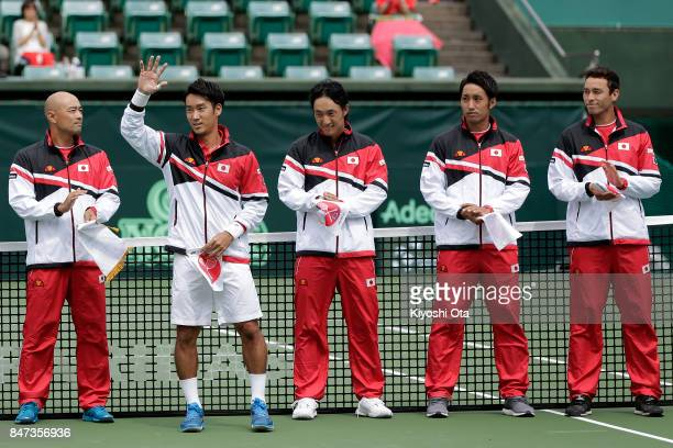 Yuichi Sugita of Japan waves to fans at the opening ceremony during day one of the Davis Cup World Group Playoff between Japan and Brazil at Utsubo...