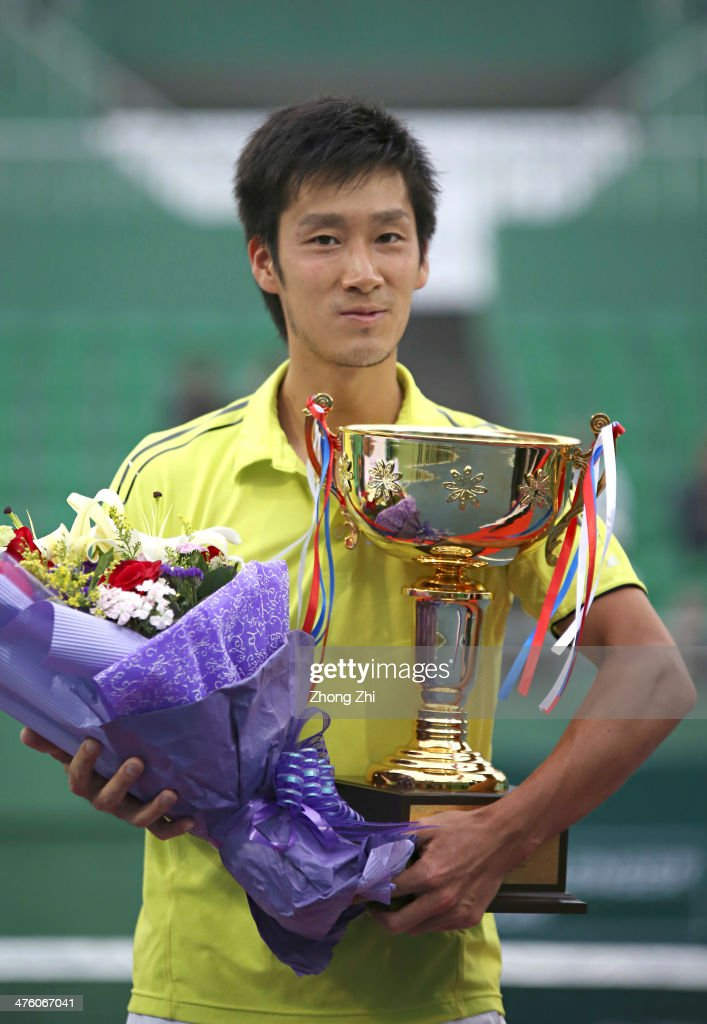 <a gi-track='captionPersonalityLinkClicked' href=/galleries/search?phrase=Yuichi+Sugita&family=editorial&specificpeople=2081175 ng-click='$event.stopPropagation()'>Yuichi Sugita</a> of Japan with his trophy after losing his final match against Blaz Rola of Slovenia during the ATP Challenger Guangzhou Tour at Guangzhou Development District International Tennis School on March 2, 2014 in Guangzhou, China.
