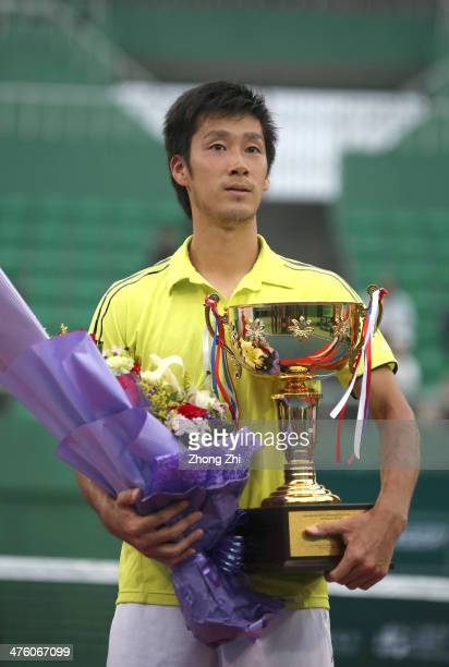 Yuichi Sugita of Japan with his trophy after losing his final match against Blaz Rola of Slovenia during the ATP Challenger Guangzhou Tour at...