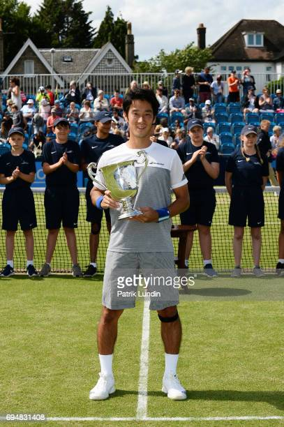 Yuichi Sugita of Japan with the trophy after victory in the final match against Jordan Thompson of Australia during the Aegon Surbiton Trophy tennis...