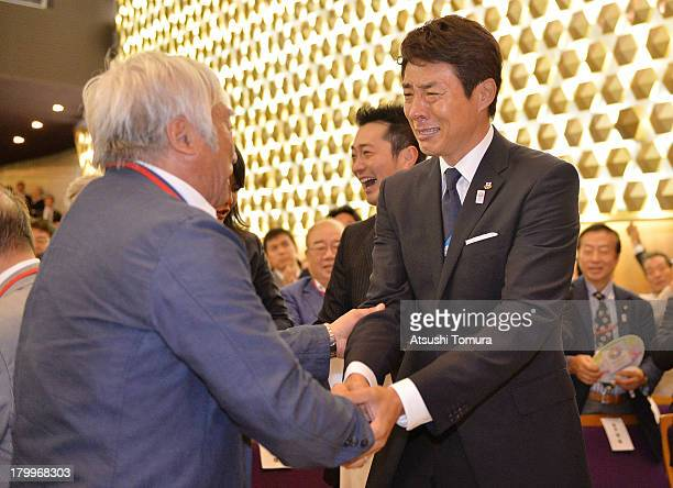 Yuichiro Miura and Shuzo Matsuoka reacts after it was announced that Tokyo has won the bid to host the 2020 Summer Olympic Games during the viewing...