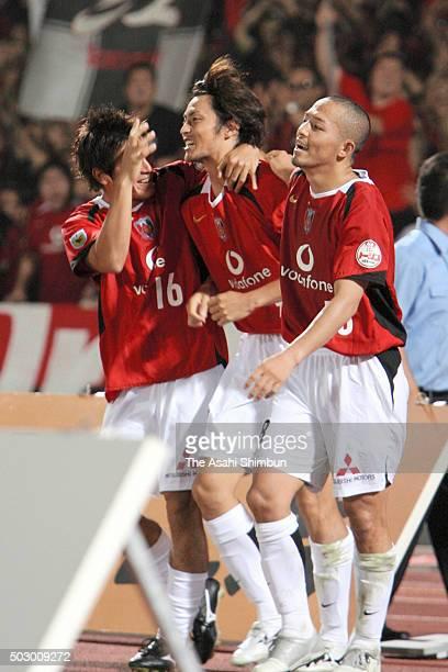 Yuichiro Nagai of Urawa Red Diamonds celebrates scoring his team's second goal with his team mates Takahito Soma and Shinji Ono during the JLeague...