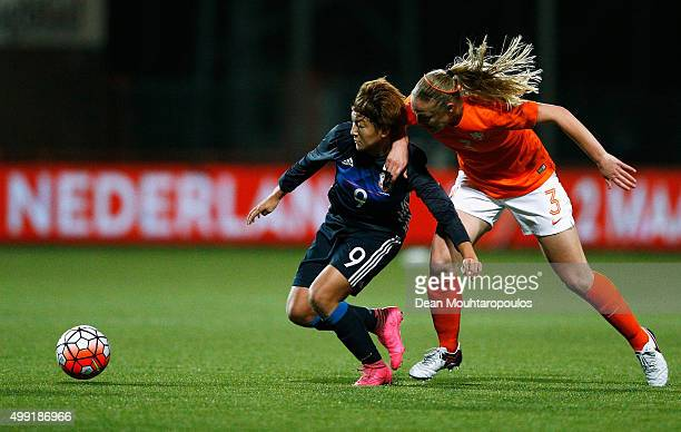 Yuika Sugasawa of Japan battles for the ball with Stefanie van der Gragt of the Netherlands during the International Friendly match between...