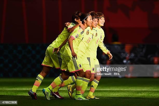Yuika Sugasawa of Japan celebrates with team mates Yuika Sugasawa and Mizuho Sakaguchi during the FIFA Women's World Cup 2015 Group C match between...