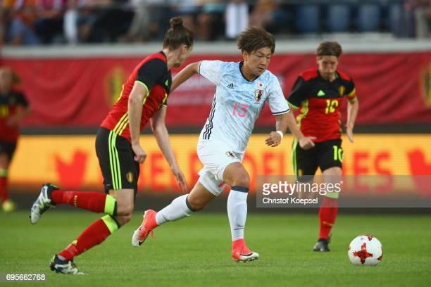 Yuika Sugasawa of Japan runs with the ball during the Women's International Friendly match between Belgium and Japan at Stadium Den Dreef on June 13...