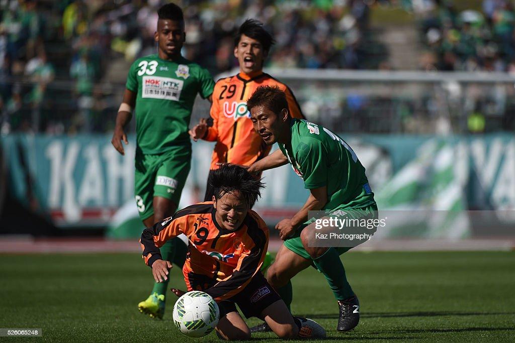 Yuji Hoshi of Renofa Yamaguchi is fouled by Yuki Fuji of FC Gifu during the J.League match between FC Gifu and Renofa Yamaguchi at the Nagaragawa Stadium on April 29, 2016 in Nagoya, Japan.