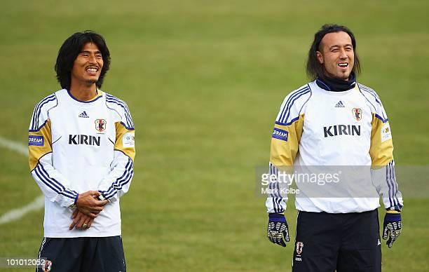 Yuji Nakazawa and Marcus Tulio Tanaka share a laugh during Japan training session at SaasFee Stadium on May 27 2010 in SaasFee Switzerland