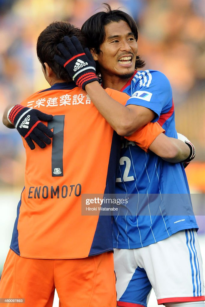 Yuji Nakazawa (R) and Tetsuya Enomoto of Yokohama F.Marinos celebrate the win after the 93rd Emperor's Cup final between Yokohama F.Marinos and Sanfrecce Hiroshima at the National Stadium on January 1, 2014 in Tokyo, Japan.
