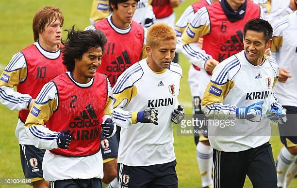 27 Yuji Nakazawa Junichi Inamoto and Yoshikatsu Kawaguchi speak as they run a lap during a Japan training session at SaasFee Stadium on May 27 2010...