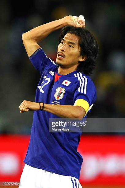 Yuji Nakazawa of Japan celebrates after victory in the 2010 FIFA World Cup South Africa Group E match between Japan and Cameroon at the Free State...