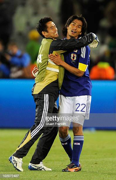 Yuji Nakazawa of Japan celebrates victory with a team mate after the 2010 FIFA World Cup South Africa Group E match between Japan and Cameroon at the...