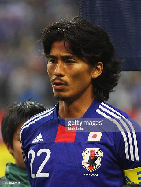 Yuji Nakazawa of Japan lines up for the national anthems before the international friendly match between Japan and South Korea at Saitama Stadium on...