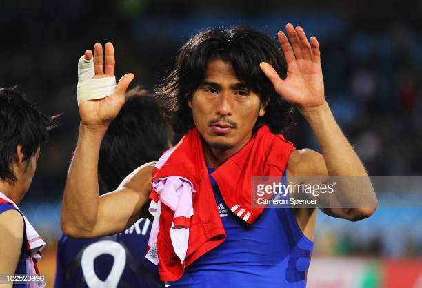 Yuji Nakazawa of Japan shows his dejection after losing a penalty shootout during the 2010 FIFA World Cup South Africa Round of Sixteen match between...