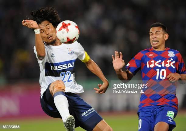 Yuji Nakazawa of Yokohama FMarinos and Dudu of Ventforet Kofu compete for the ball during the JLeague J1 match between Ventforet Kofu and Yokohama...
