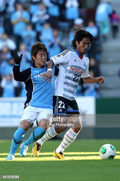 Yuji Nakazawa of Yokohama FMarinos and Ryohei Yamazaki of Jubilo Iwata compete for the ball during the JLeague match between Jubilo Iwata and...