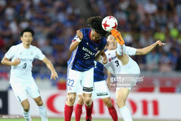 Yuji Nakazawa of Yokohama FMarinos and Shuhei Otsuki of Vissel Kobe compete for the ball during the JLeague J1 match between Yokohama FMarinos and...