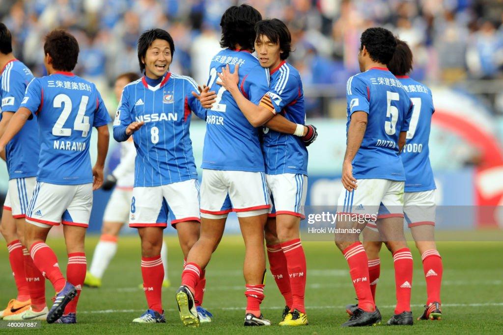 Yuji Nakazawa (4th R) of Yokohama F.Marinos celebrates scoring his team's second goal with his team mate Shunsuke Nakamura (3rd R) during the 93rd Emperor's Cup final between Yokohama F.Marinos and Sanfrecce Hiroshima at the National Stadium on January 1, 2014 in Tokyo, Japan.