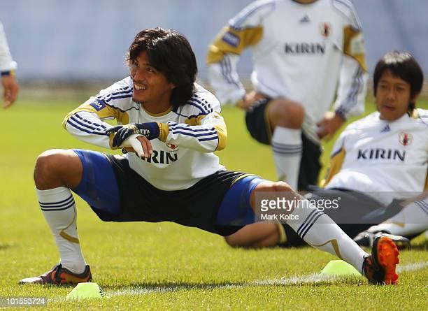 Yuji Nakazawa stretches during a Japan training session at SaasFee Stadium on June 2 2010 in SaasFee Switzerland