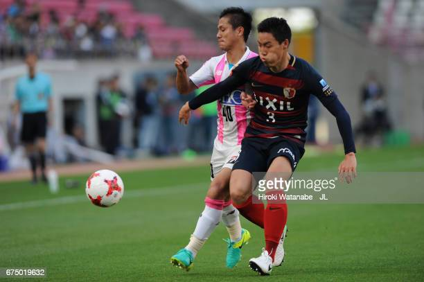 Yuji Ono of Sagan Tosu and Gen Shoji of Kashima Antlers compete for the ball during the JLeague J1 match between Kashima Antlers and Sagan Tosu at...