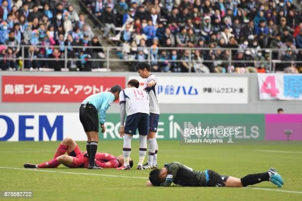 Yuji Ono of Sagan Tosu and Takuo Okubo of FC Tokyo lie injured after their collision during the JLeague J1 match between Sagan Tosu and FC Tokyo at...