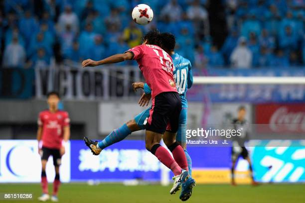 Yuji Ono of Sagan Tosu and Yasuki Kimoto of Cerezo Osaka compete for the ball during the JLeague J1 match between Sagan Tosu and Cerezo Osaka at Best...