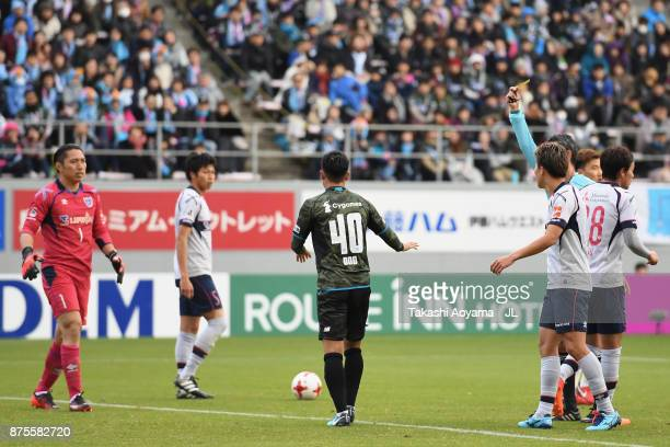 Yuji Ono of Sagan Tosu is shown a yellow card by referee Itaru Hirose during the JLeague J1 match between Sagan Tosu and FC Tokyo at Best Amenity...